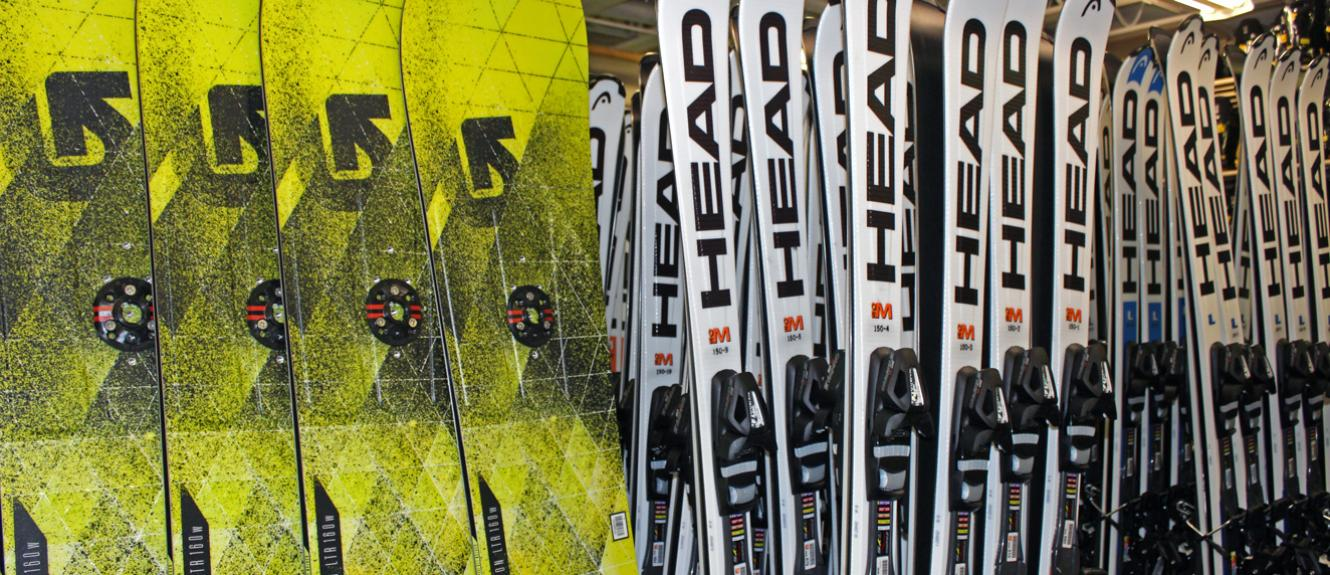 Snowboards And Skis Lined Up And Ready To Rent