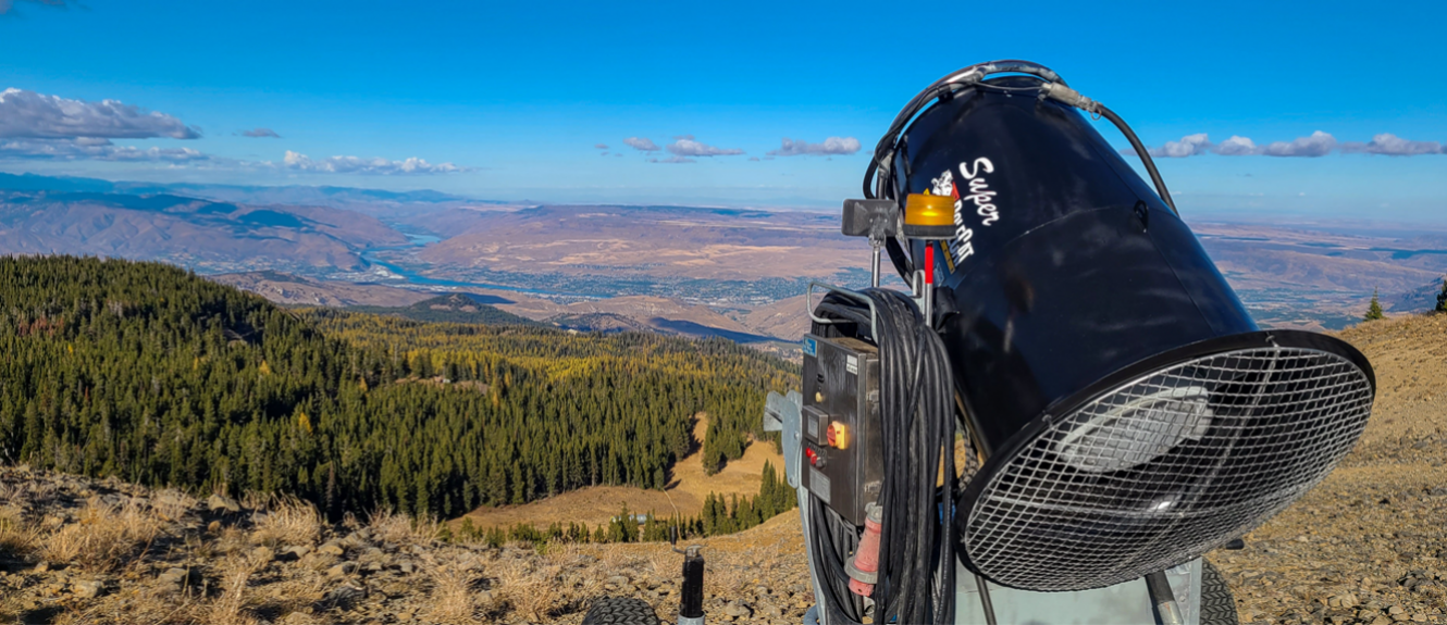 snowgun at the top of the ridge looking over the valley with the Columbia River in the Background