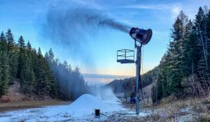 Snowmaking tower gun and pile of snow