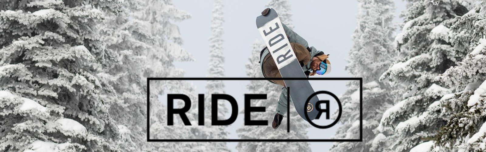 snowboarder in the air grabbing his board with trees in the background and a Ride Logo over top.