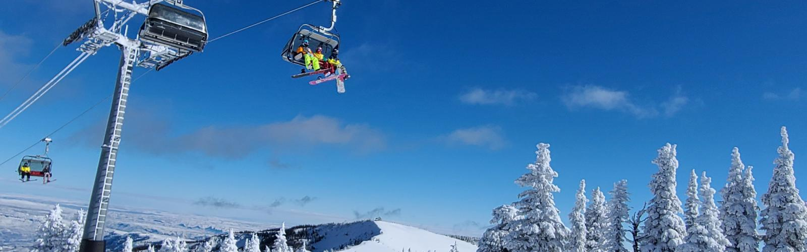 Riders on the Wenatchee Express Chairlift with Microwave and Windy Ridge in the background