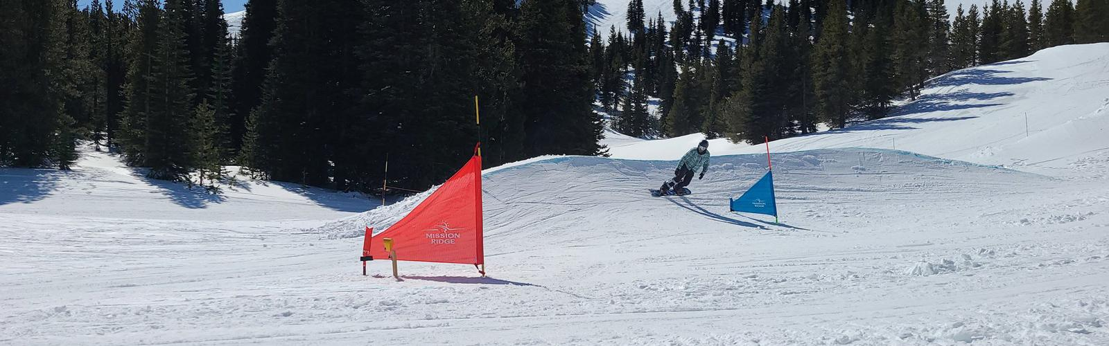 Snowboarder on banked slalom course