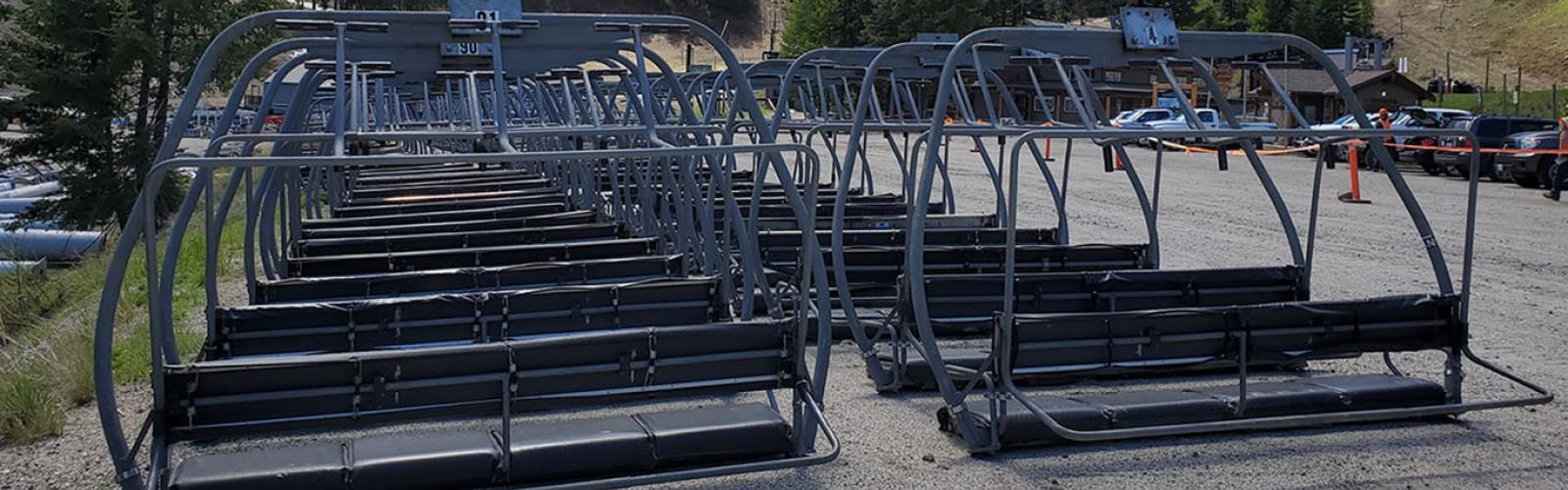 Chairlift Chairs Sitting In Parking Lot