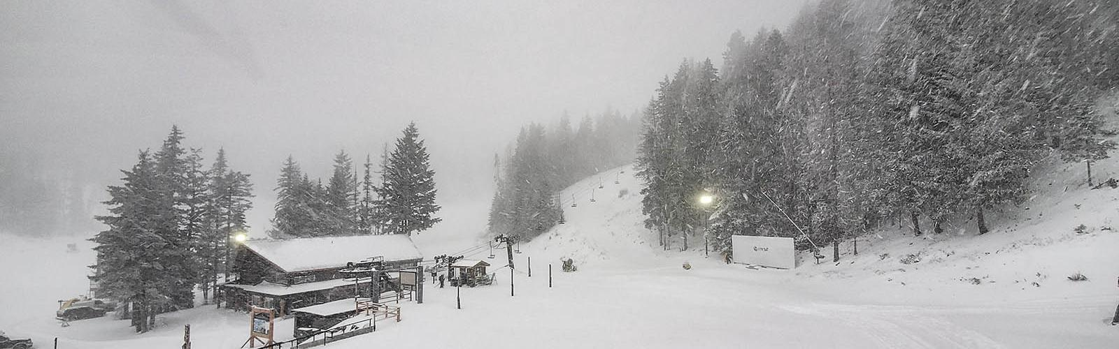 Mission Ridge Base Area covered in snow with snow falling