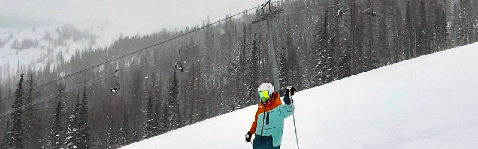 Skier waving on stormy day