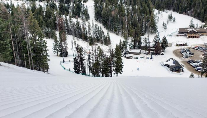 Close Up Of Groomed Snow with Base Area below