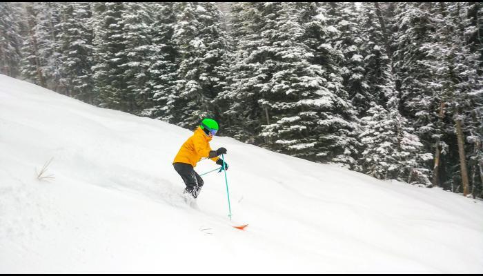 Skier making powder turn