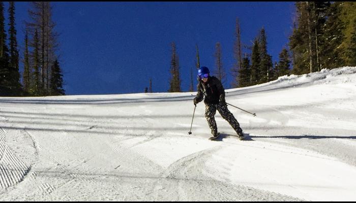 child skiing groomed run