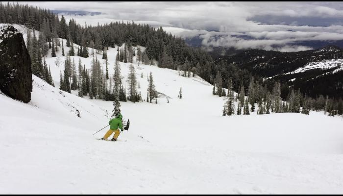 child skiing bomber bowl with Wenatchee valley in background