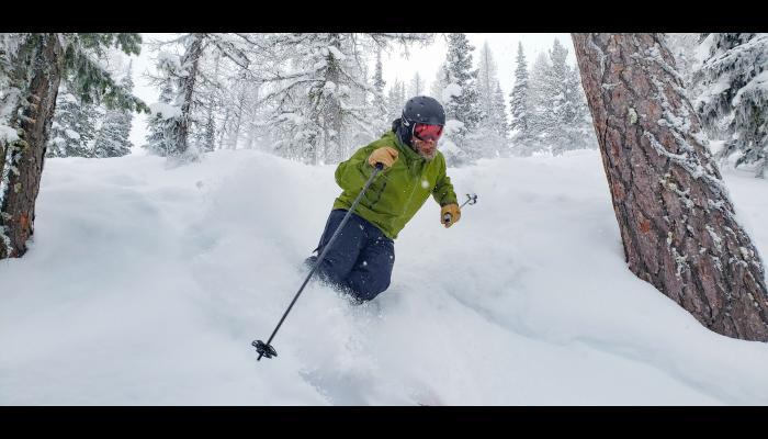 Close up of skier making powder turn