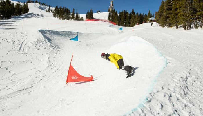 snowboarder making a turn in the bomber banked slalom contest