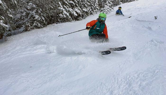 Young skier performing a nice powder turn