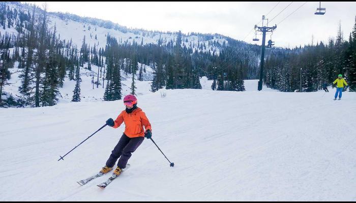 Female skiers on groomed slope