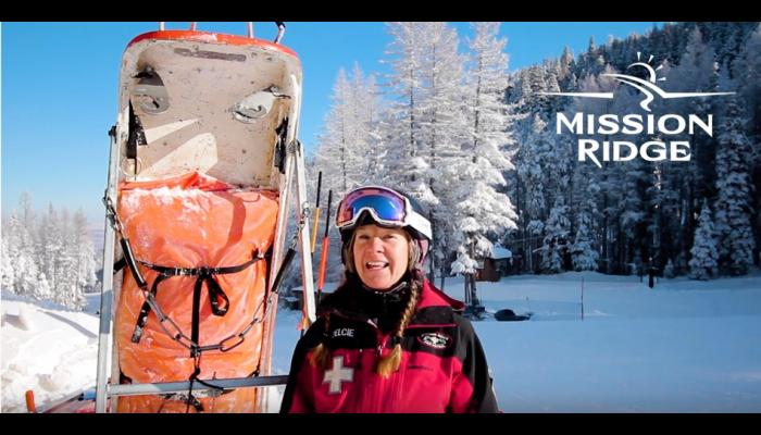 Ski Patrol in front of camera with skiers passing by