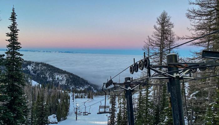 Looking down from the top of Chair 4 with sunset and inversion layer