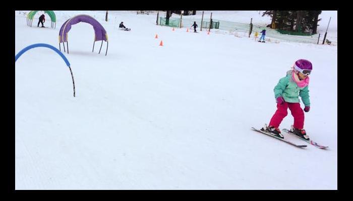 Child skiing on beginner slope