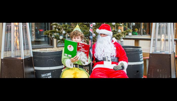 Buddy the Elf reading Santa How The Grinch Stole Christmas