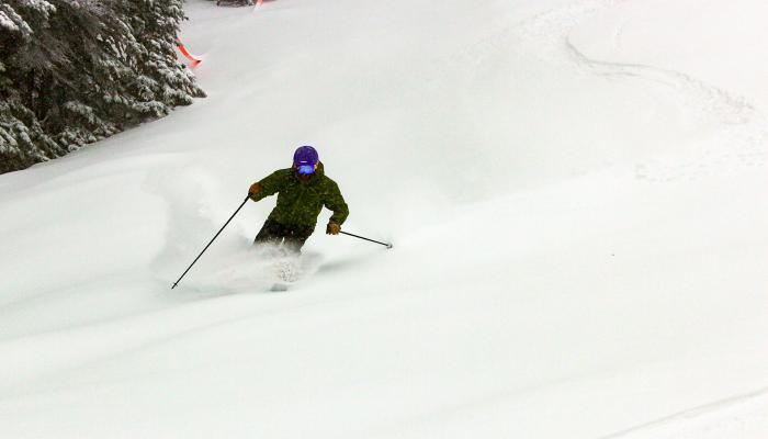 Skier making turn in powder