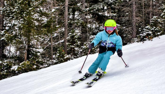 Young skier making turn in the snow