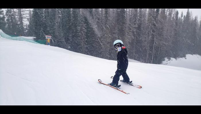 Kid skier giving thumbs up on Castle run off of Chair 4