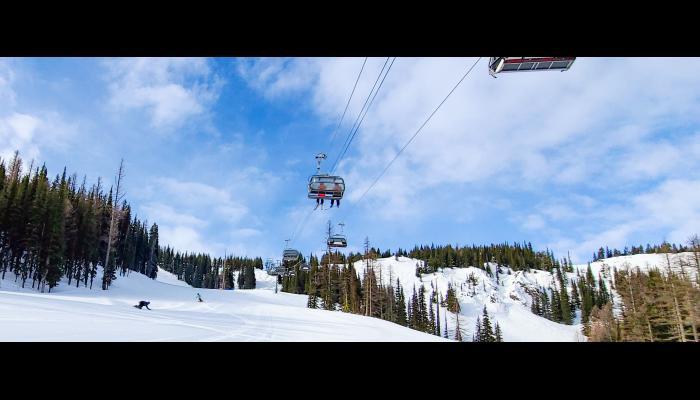 skier fresh corduroy under the wenatchee express chairlift