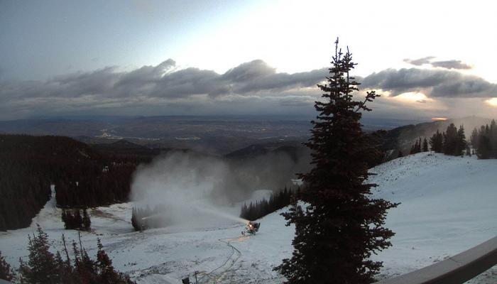 Snowmaking gun making snow with valley below