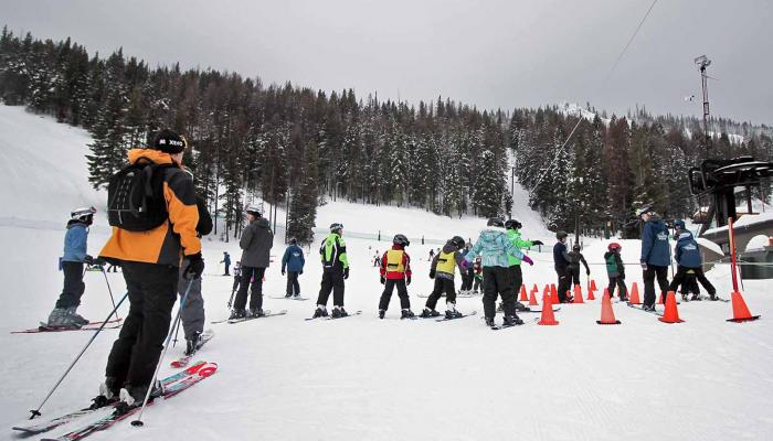 Skiers in line at the beginner rope tow