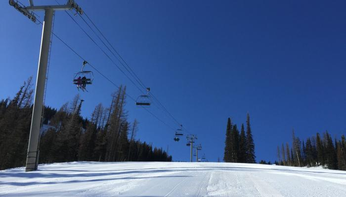 sunny groomed run chairlift view